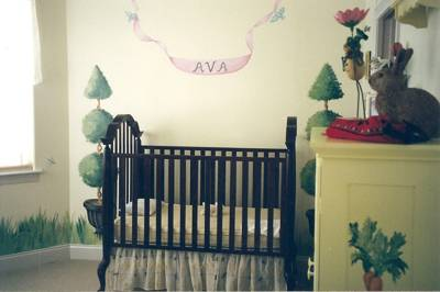 Murals and painted furniture in a baby room